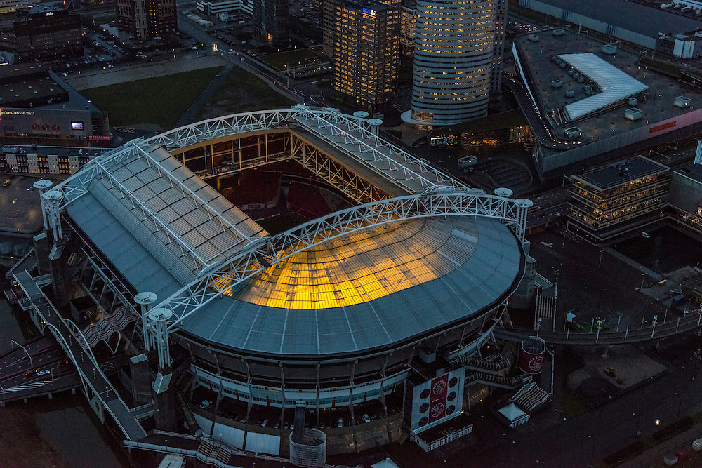Nederland, Noord-Holland, Amsterdam, 16-01-2014; Amsterdam Zuidoost,  Arenagebied met Ziggo Dome, Woonmall en e Arena. Dak van het stadion is geopend, het gras van het voetbaldveld wordt belicht door speciale groeilampen.<br /> Amsterdam Zuidoost, Arena area with Ziggo Dome, Woonmall and Arena Ajax Stadium. The stadium roof is open, the grass of the football field is lighted using special grow lights.<br /> luchtfoto (toeslag op standaard tarieven);<br /> aerial photo (additional fee required);<br /> copyright foto/photo Siebe Swart.