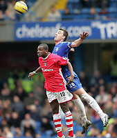 Photo: Lee Earle.<br /> Chelsea v Charlton Athletic. The Barclays Premiership. 22/01/2006. Chelsea's John Terry (R) battles in the air with Darren Bent.