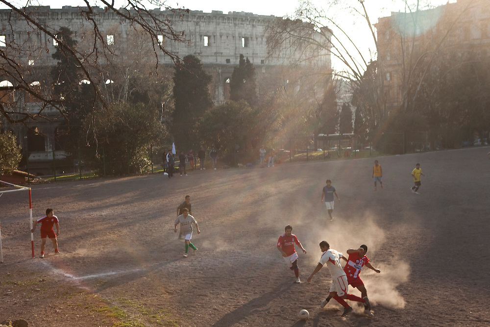 ROME, ITALY: Football game on a sand pitch just next to the Roman Colisseum.