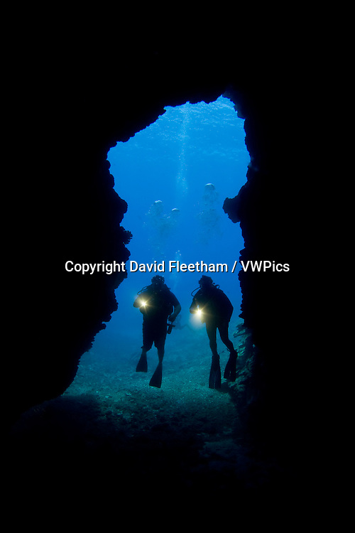Divers (MR) pictured at the enterance to First Cathedral off the Island of Lanai, Hawaii.