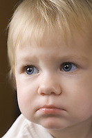 Blonde 14 month old with downcast expression