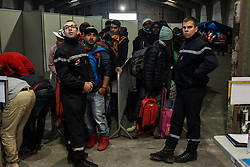October 25, 2016 - Calais, France - Migrants stand at the register center at the Calais Jungle  in Calais, France, on 25 October 2016 in a cue to get into the hall from which they are distributed in the buses. Up to the evening, about 4,000 migrants from the Refugee camp on the coast at the English Channel were distributed to several regions in France. The police have begun to tear down the huts and tents in the camp. (Credit Image: © Markus Heine/NurPhoto via ZUMA Press)