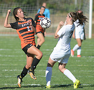 Pennsbury's Christine Cataldo-Smith (21) and Abington's Isabelle Mugnier (7) fight for a loose ball in the first half Wednesday, October 04, 2017 at Abington High School in Abington, Pennsylvania. (Photo by William Thomas Cain)