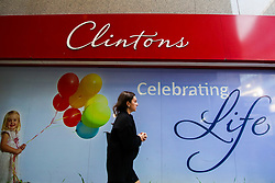© Licensed to London News Pictures. 11/11/2019. London, UK. A woman walks past Clintons card store in City of London. Clintons are shutting down one in five of its stores with fears growing that the greeting card chain is on the brink of collapse, putting 2,500 jobs at risk. Photo credit: Dinendra Haria/LNP