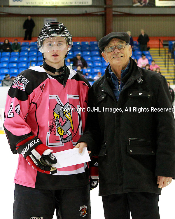 NEWMARKET, ON - Feb 9 : Ontario Junior Hockey League Game Action between the St. Michaels Buzzers and the Newmarket Hurricanes, Ian Farrell #24 of the Newmarket Hurricanes Hockey Club receives player of the game honours.<br /> (Photo by Brian Watts / OJHL Images)