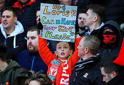 A young Liverpool fan holds up a banner asking Liverpool's Loris Karius for his shirt - Mandatory by-line: Matt McNulty/JMP - 24/02/2018 - FOOTBALL - Anfield - Liverpool, England - Liverpool v West Ham United - Premier League