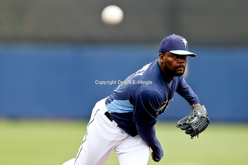 Mar 2, 2013; Port Charlotte, FL, USA; Tampa Bay Rays relief pitcher Fernando Rodney (56) throws against the Baltimore Orioles during the bottom of the third inning of a spring training game at Charlotte Sports Park. Mandatory Credit: Derick E. Hingle-USA TODAY Sports
