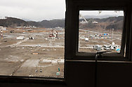Views looking out from the broken windows of Minami-Sanriku Hospital, across the devastated town, on the 1 year anniversary of the March 11th 2011 earthquake and tsunami, in Minami-Sanriku, Tohoku region, Japan on Sunday 11th March 2012.