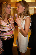 Alex Findlay and Noelle Reno, Burberry party to launch collection in  support of Breakthrough Breast Cancer. New Bond St. shop. Londddon. 5 October 22004. ONE TIME USE ONLY - DO NOT ARCHIVE  © Copyright Photograph by Dafydd Jones 66 Stockwell Park Rd. London SW9 0DA Tel 020 7733 0108 www.dafjones.com