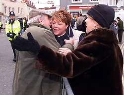 .TTP11-AP-BOXING DAY HUNT-DIG..PIC BY ANDREW PARSONS . BOXING DAY HUNT IN MALDON , ESSEX. THE ESSEX FARMERS HUNT STARTS IN MALDON HIGH ST .LOCAL FARMER DERRICK GARNER  WHO IS PRO HUNTING GREETS HIS FRIENDS WHO ARE ANTI HUNTING LORAINE LOWRY ( RIGHT, MOTHER) AND KERIE LOWRY Boxing Day Hunt in Maldon, Essex. .The Essex farmers hunt starts in Maldon High St. 2000 .Photo by Andrew Parsons/i-Images....
