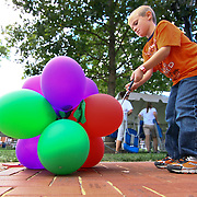 09/30/12 - Newark, DE - The Taste of Newark - Christopher Kent (7) pops ballons during the clean up efforts at The Taste of Newark event at Old College Lawn on the University of Delaware main campus Sunday, Sept. 30 2012, in Newark DE...SAQUAN STIMPSON/Special to The News Journal