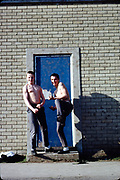 Parslow and Edema stood outside blue door High Wycombe, UK, April 1982