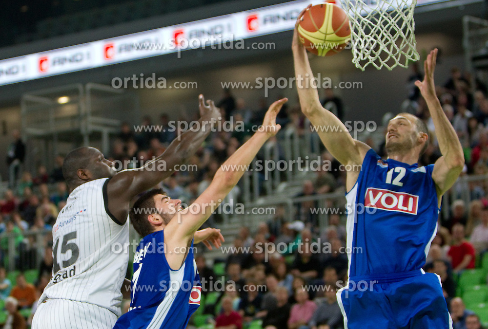 Nathan Jawai  of Partizan vs Bojan Dubljevic of Buducnost and Marko Simonovic of Buducnost during first semi-final match of Basketball NLB League at Final four tournament between KK Partizan Belgrade, Serbia and KK Buducnost Podgorica, Montenegro, on April 19, 2011 in Arena Stozice, Ljubljana, Slovenia. (Photo By Vid Ponikvar / Sportida.com)