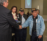 Houston ISD trustee Manuel Rodriguez introduces members of the Gathering of Eagles during Veterans recognitions during the Board of Education meeting, November 13, 2014.