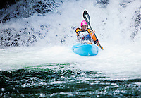 A female kayaker on the Snoqualmie river, Washington, USA. Fall in the Wall.