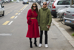 January 15, 2018 - Milan, Italy - Couple Anna dello Russo wearing red coat with brown belt, black ankle boots and Angelo Gioia is seen outside Fendi during Milan Men's Fashion Week Fall/Winter 2018/19 on January 15, 2018 in Milan, Italy. (Credit Image: © Nataliya Petrova/NurPhoto via ZUMA Press)
