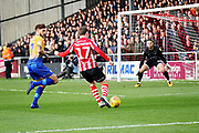 Lincoln City Shay McCartan(17) lines up a shot during the EFL Sky Bet League 2 match between Lincoln City and Mansfield Town at Sincil Bank, Lincoln, United Kingdom on 24 November 2018.