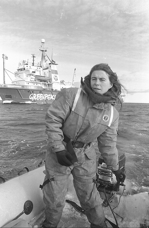 Greenpeace Antarctica Expedition 1988/89.  GONDWANA crew member Maggie McCaw steering inflatable.  GONDWANA behind.  Accession #: 1.89.003.143.23