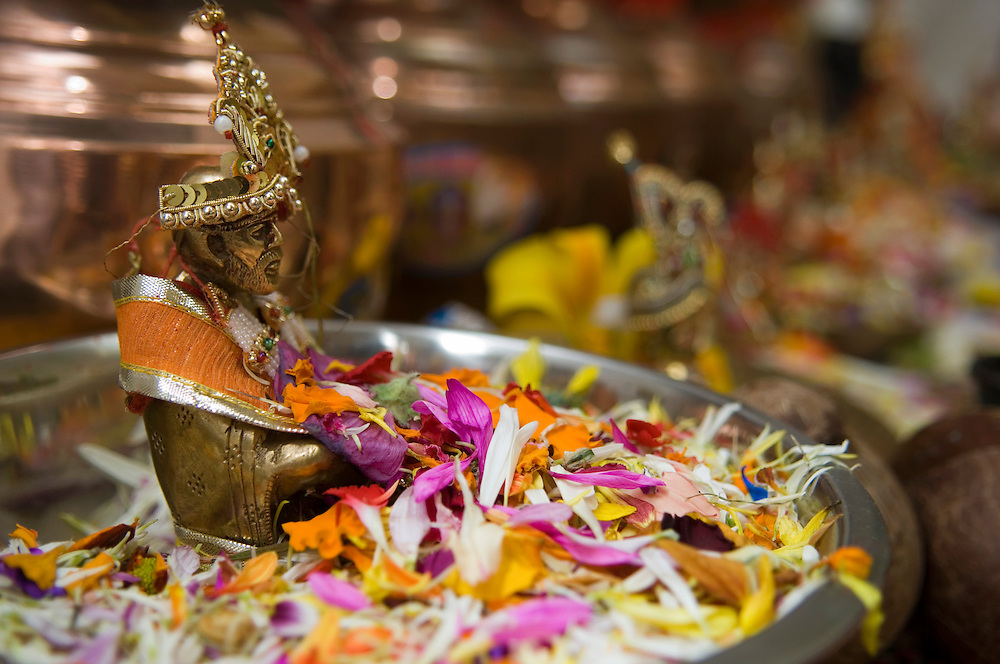 Devotee and offerings at an opening of an  Hindu temple