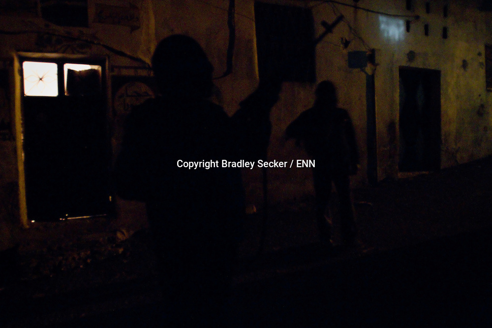 Members of the Free Syrian Army patrol and guard against sniper attacks at night, Al Janoudiyah, Syria