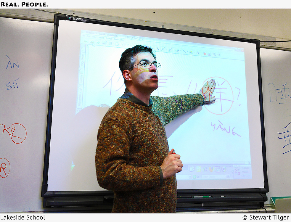 A Lakeside teacher using a smart board to teach Chinese.