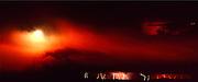 Lightning storm, sun through clouds, panorama