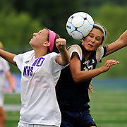 Kris Wilson/News Tribune<br /> Helias midfielder Maddison Lammers takes the brunt of the ball on the side of the head as she beats out Kearney's Gloria Hanrahan for control of a free kick during the Crusaders' and Bulldogs' semifinal matchup in the MSHSAA Class 2 soccer championships at Blue Springs South High School. Kearney would go on to win the game 2-1 in extra time.