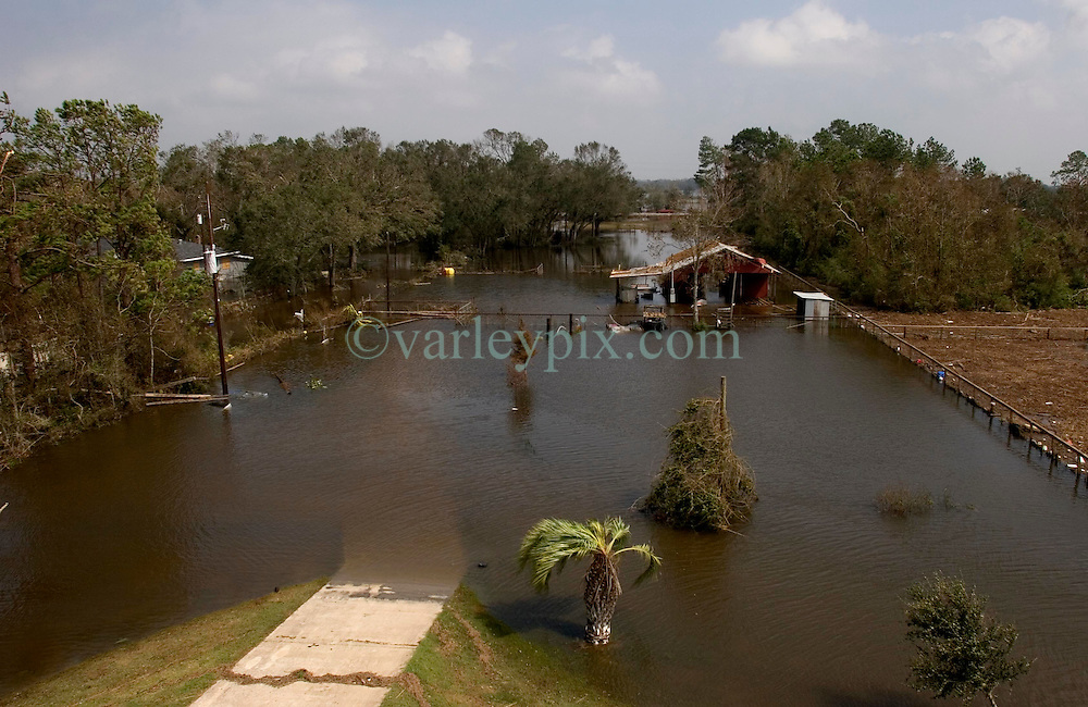 25 Sept, 2005.  Carlyss, Louisiana. Hurricane Rita aftermath. <br /> Carlyss, Louisiana (20 miles north of ravaged Cameron). One day after the storm hit. View from local cajun man Aaron Stokes' fathers' roof.<br /> Photo; &copy;Charlie Varley/varleypix.com