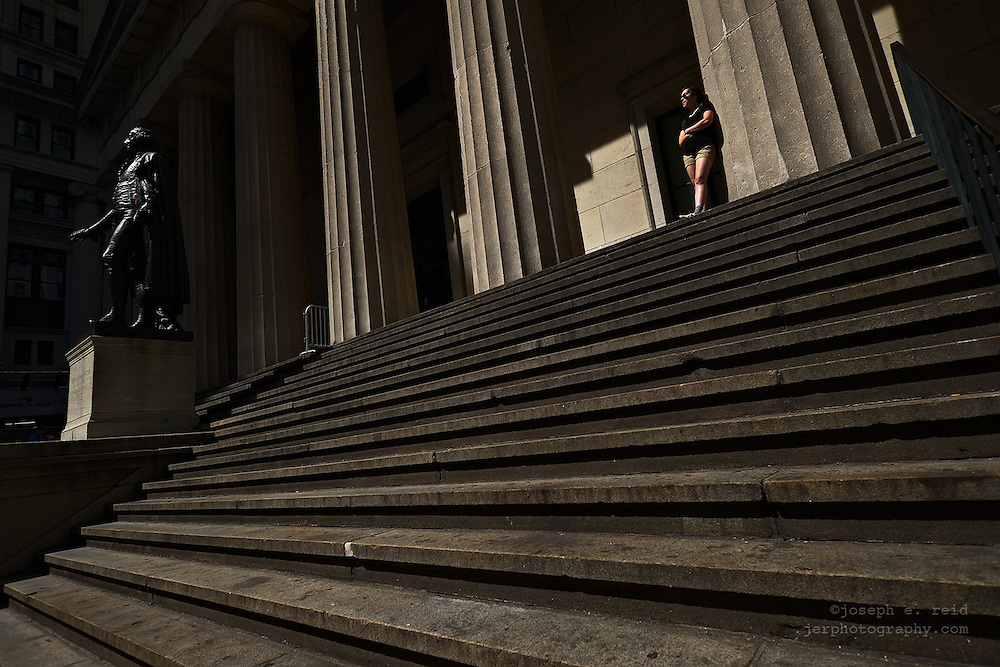 Woman on steps of Federal Hall, New York, NY, US