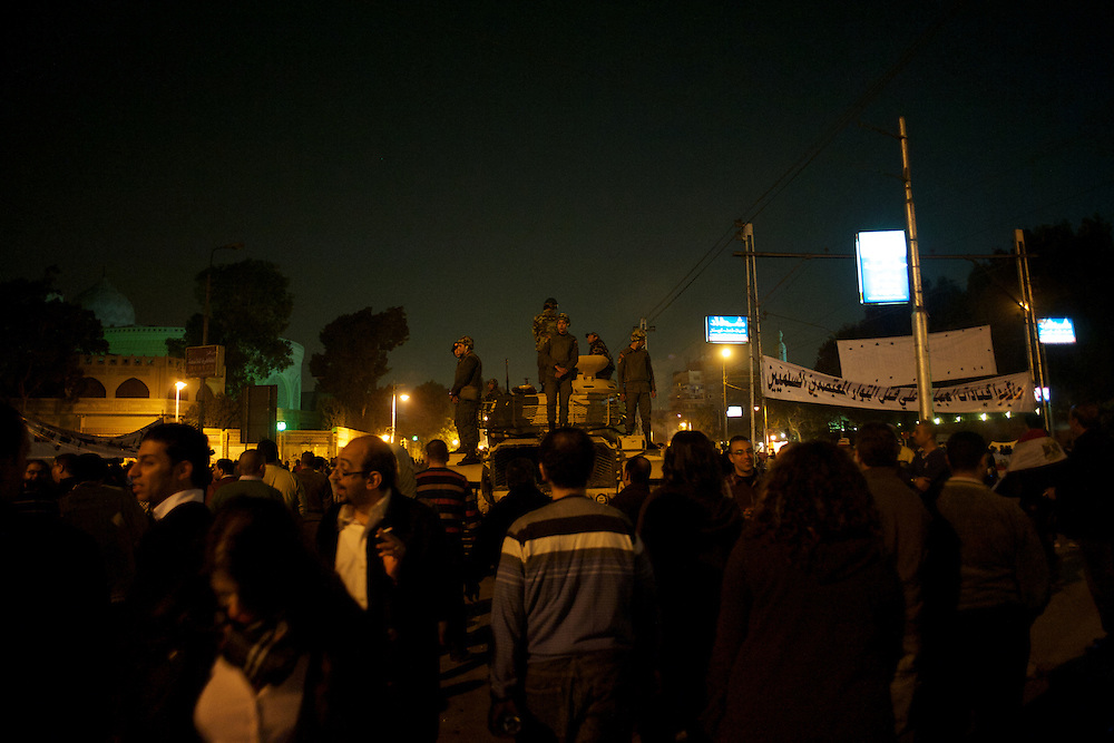 December 09, 2012 - Cairo, Egypt: Thousands gather outside the presidential place in Cairo to voice their anger at the planned constitution, which will be put to a referendum next Saturday...The Egyptian army has reportedly called talks between President Mohamed Morsi and the opposition to end violent protests against a draft constitution...Sporadic clashes between supporters and opponents of president Mohamed Morsi, erupted in the past week over his assumption of extraordinary powers and the scheduling of the referendum. (Paulo Nunes dos Santos/Polaris)