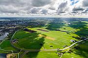 Nederland, Zuid-Holland, Zoetermeer, 28-04-2017; overzicht van de Zoetermeersche Meerpolder, een van de weinige polder is de westelijke Randstad die nog een open landschap heeft. Zoetermeer aan de horizon Polder near Zoetermeer in the western Randstad, one of the few still open landscapes<br /> luchtfoto (toeslag op standard tarieven);<br /> aerial photo (additional fee required);<br /> copyright foto/photo Siebe Swart