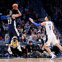 11 November 2017: Denver Nuggets guard Jamal Murray (27) takes a jump shot over Orlando Magic center Nikola Vucevic (9) during the Denver Nuggets 125-107 victory over the Orlando Magic, at the Pepsi Center, Denver, Colorado, USA.