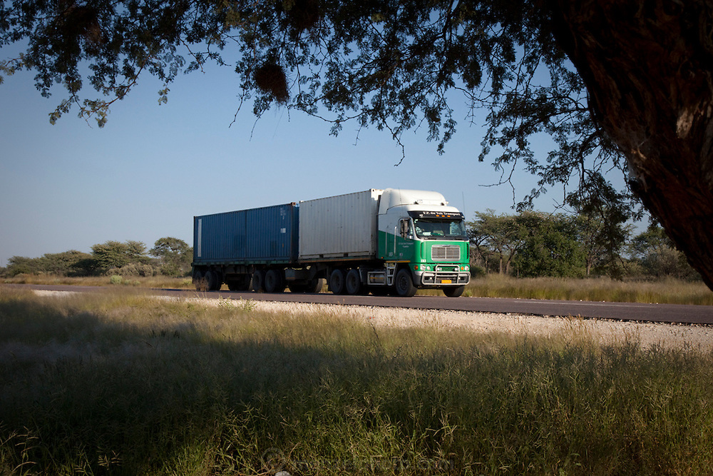 A haulage truck on the trans-Kalahari highway near the Botswana border in Namibia. With no comprehensive railway networks to move cargo between countries in southern Africa, haulage trucks serve as the primary means of transport for the bulk of regional trade.