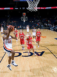 Virginia guard Monica Wright (22) leaps for an uncontested layup against Davidson.  The Virginia Cavaliers women's basketball team defeated the Davidson Wildcats 83-68 at the John Paul Jones Arena in Charlottesville, VA on December 20, 2007.