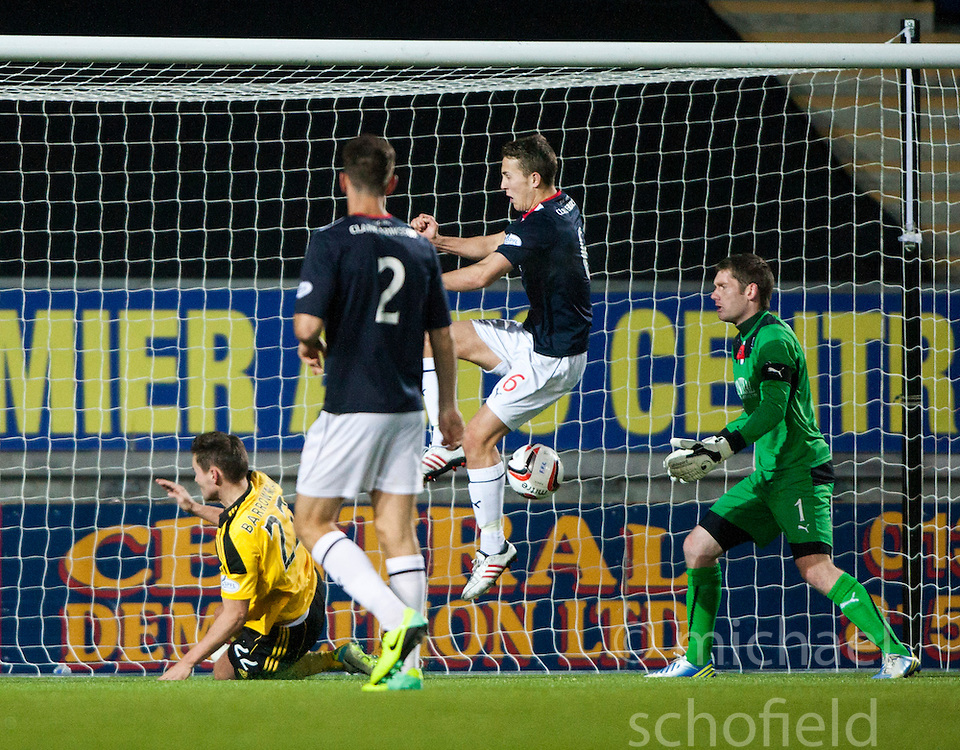 Falkirk's Will Vaulks clears the ball off  Livingston Andy Barrowman.<br /> Falkirk 4 v 1 Livingston, Scottish Championship game played today at the Falkirk Stadium.