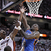 19 June 2012: Oklahoma City Thunder center Kendrick Perkins (5) goes for the layup over Miami Heat power forward Chris Bosh (1) during the first quarter of Game 4 of the 2012 NBA Finals, Thunder at Heat, at the AmericanAirlinesArena, Miami, Florida, USA.