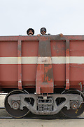 Passengers on board of the Iron ore train of zouerat, the longest and heaviest train in the world, Nouadhibou, Western Africa, Mauretania, Africa