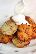 Potato pancakes (Yiddish: latkes or latkas) Traditionally eaten during Chanukkah with soar cream
