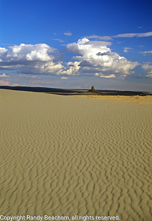 Killpecker Sand Dunes with Boars Tusk, a volcanic plug, in the background. Red Desert in the Great Divide Basin, Wyoming