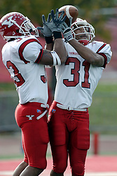 28 October 2006: Josh Cayson (33) and Da'Michael Horne both attempt to catch a kick off. Horne gets the toss up. Youngstown State turned off over 15,000 fans as the win blew their way, cooling off Illinois State 27-13. Nationally ranked teams Youngstown State Penguins and Illinois State Redbirds competed at Hancock Stadium on the campus of Illinois State University in Normal Illinois.<br />