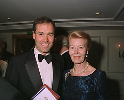LADY BARBARA BOSSOM and her son MR BRUCE BOSSOM,  at a dinner in London on April 14th 1997.LXO 51