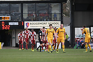 The Newport players head back to restart the match after Ashley Vincent's opening goal for Cheltenham Town. Skybet football league 2 match, Newport county v Cheltenham Town at Rodney Parade in Newport, South Wales on Saturday 22nd Feb 2014.<br /> pic by Mark Hawkins, Andrew Orchard sports photography.