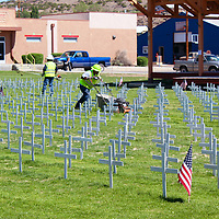 City of Grants workers prepare the Field of Honor Friday at Fire & Ice Park for Monday's tribute to the fallen heroes of Cibola County.