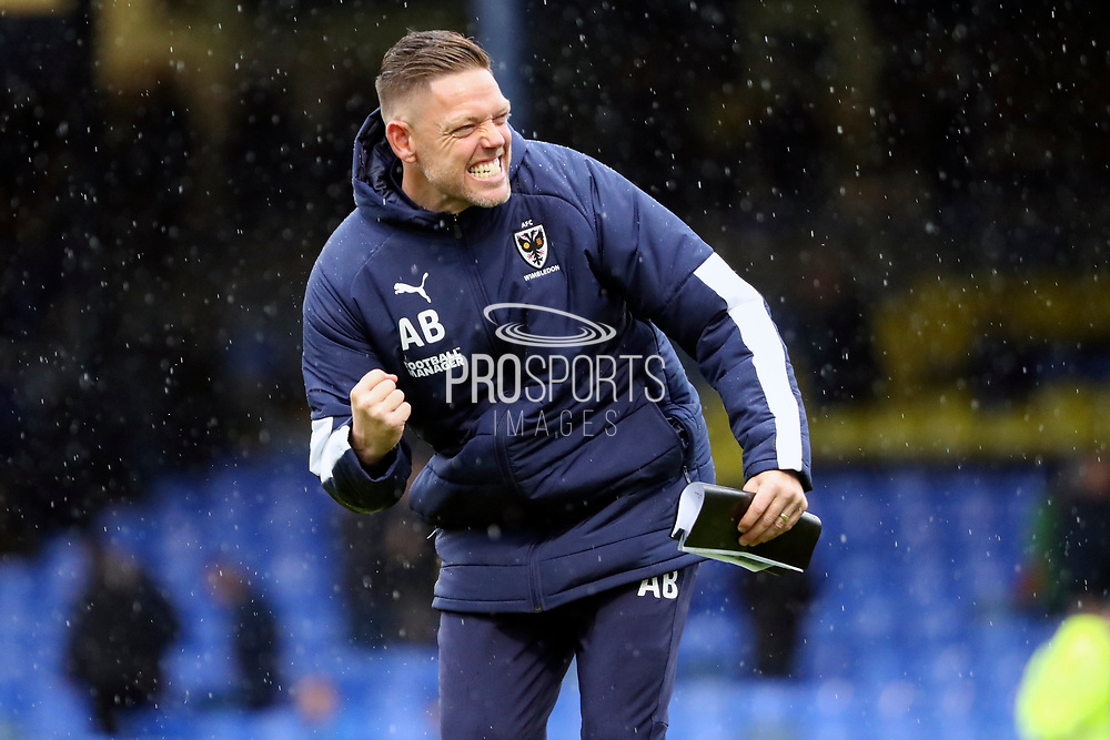 AFC Wimbledon goalkeeping coach Ashley Bayes with a fist pump during the EFL Sky Bet League 1 match between Southend United and AFC Wimbledon at Roots Hall, Southend, England on 12 October 2019.