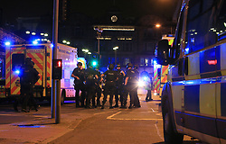 Armed police at Manchester Arena after reports of an explosion at the venue during an Ariana Grande gig.