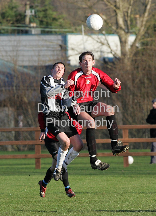 6/1/2006.Pictured in action at the Nationalist Carlow League V Amateur Football League match in the Meadows, Carlow on Saturday was Nationalist Carlow League's Ray Buggy (left) and Amateur Football League's Martin McGee..Picture Dylan Vaughan.