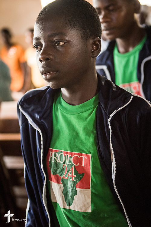 A young man in the Othoro ELCK (Evangelical Lutheran Church in Kenya) Project 24 program prays during worship at the Othoro Lutheran congregation adjacent to the boarding facility on Sunday, Oct. 18, 2015, in Kisumu, Kenya. LCMS Communications/Erik M. Lunsford