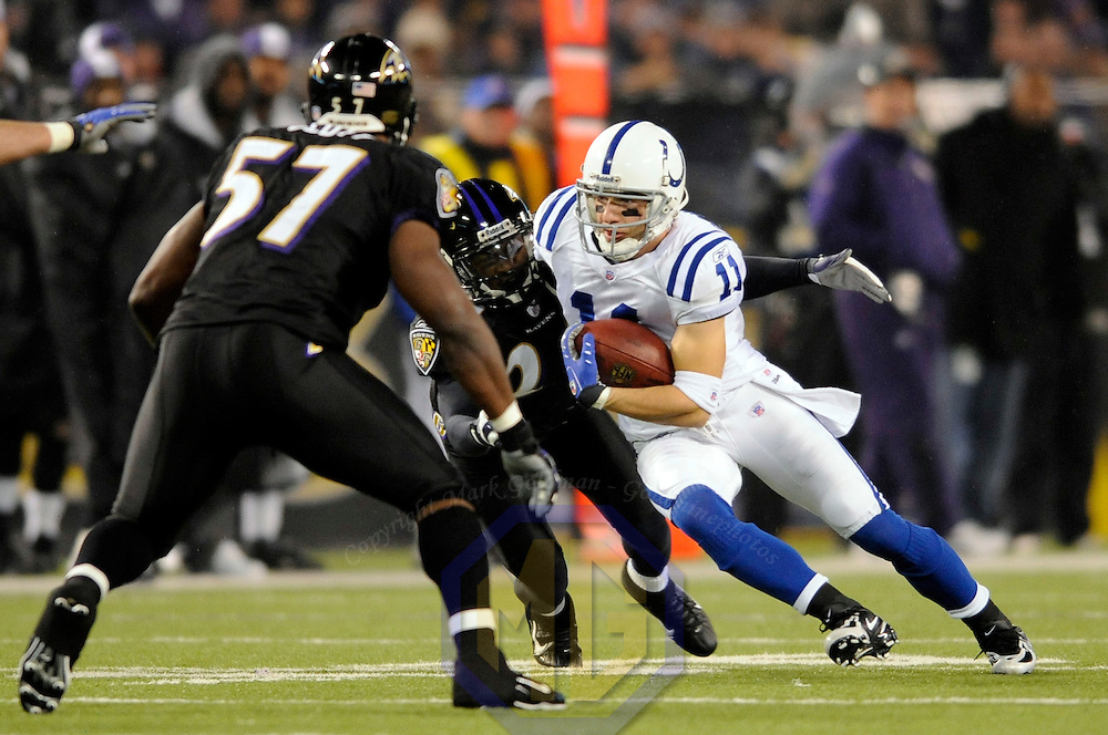 09 December 2007:  Indianapolis Colts wide receiver Anthony Gonzalez (11) catches a pass for a 15-yard gain in the 1st quarter against Baltimore Ravens cornerback David Pittman (24) on December 9, 2007 at M&T Bank Stadium in Baltimore, Maryland. The Colts defeated the Ravens 44-20 who lost for a franchise record seventh time....