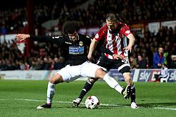 Derik Osede of Bolton Wanderers challenges Lasse Vibe of Brentford - Mandatory by-line: Robbie Stephenson/JMP - 05/04/2016 - FOOTBALL - Griffin Park - Brentford, England - Brentford v Bolton Wanderers - Sky Bet Championship