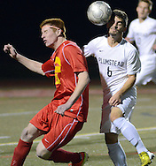 FRANCONIA, PA - NOVEMBER 11: Moravian Academy's Kevin Laughlin #24 and Plumstead Christian Academy's James Garrity #6 attempt to head a ball in the first half of the District One Class A semifinal soccer playoff game at Souderton High School November 11, 2014 in Franconia, Pennsylvania.  (Photo by William Thomas Cain/Cain Images)